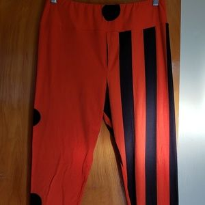 Lularoe TC leggings. Orange and black. Stripped on